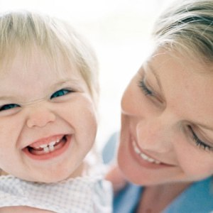 mom-holding-baby-smiling-photo-420x420-ts-78192880